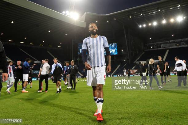 Kyle Bartley of West Bromwich Albion leaves the pitch as the team celebrate promotion to the Premier League on the pitch at the end of the Sky Bet...