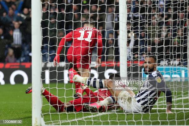 Kyle Bartley reacts after Callum Robinson of West Bromwich Albion thinks he has won the game in the last minute of the game but the goal is ruled out...
