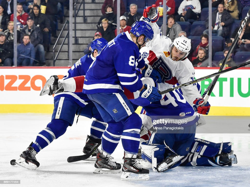 Kyle Baun #12 of the Laval Rocket falls over goaltender Garret Sparks #40 of the Toronto Marlies during the AHL game at Place Bell on November 1, 2017 in Laval, Quebec, Canada. The Toronto Marlies defeated the Laval Rocket 3-0.