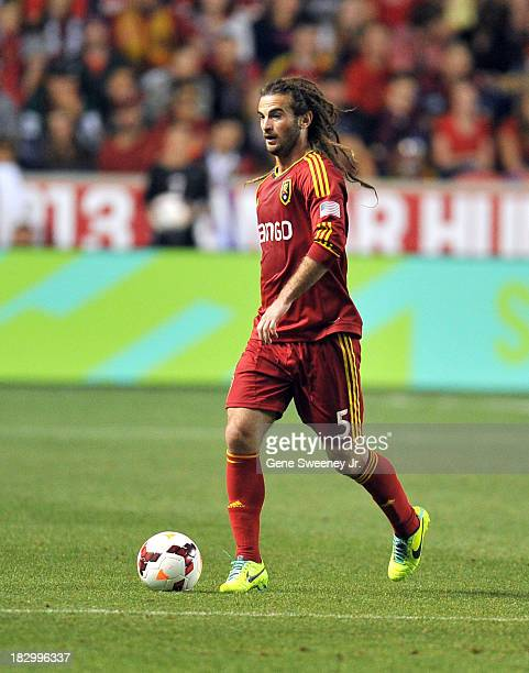 Kyle Beckerman of Real Salt Lake dribbles the ball against DC United during the 2013 US Open Cup Final at Rio Tinto Stadium October 1 2013 in Sandy...