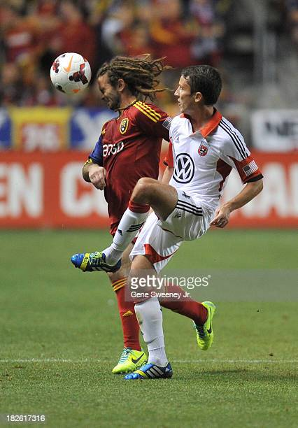 Kyle Beckerman of Real Salt Lake heads the ball away from Lewis Neal of DC United at Rio Tinto Stadium October 1 2013 in Sandy Utah