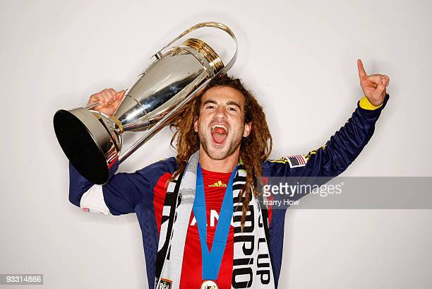 Kyle Beckerman of Real Salt Lake poses with the Philip F Anschutz MLS Cup trophy following their win in the MLS Cup final at Qwest Field on November...