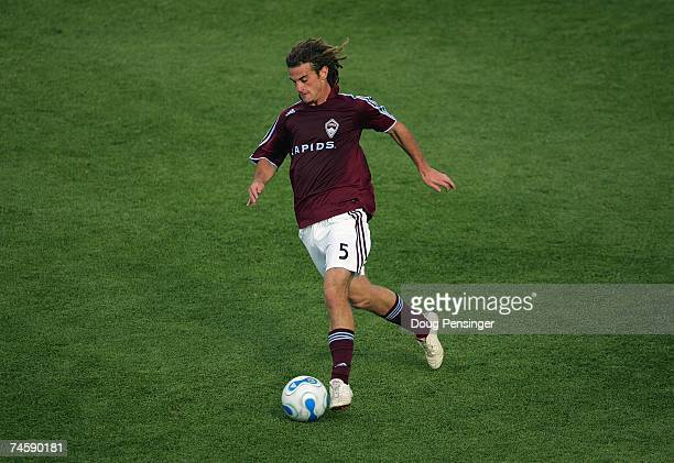 Kyle Beckerman of the Colorado Rapids moves the ball across midfield against the Los Angeles Galaxy during their MLS match at Dick's Sporting Goods...