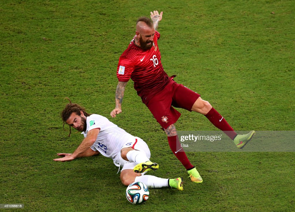 Kyle Beckerman of the United States tackles Raul Meireles of Portugal during the 2014 FIFA World Cup Brazil Group G match between the United States and Portugal at Arena Amazonia on June 22, 2014 in Manaus, Brazil.