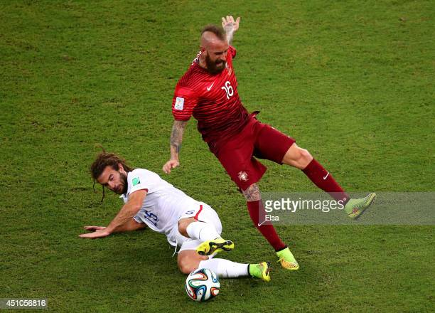Kyle Beckerman of the United States tackles Raul Meireles of Portugal during the 2014 FIFA World Cup Brazil Group G match between the United States...