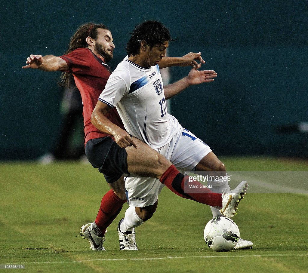 Kyle Beckerman #6 of the USA and Roger Espinoza #17 of Honduras battle for the ball at Sun Life Stadium on October 8, 2011 in Miami Gardens, Florida.