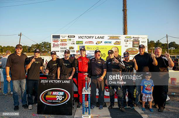 Kyle Benjamin driver of the Chevrolet poses with his team after winning the NASCAR KN Pro Series East Kevin Whitaker Chevrolet 140 at Greenville...