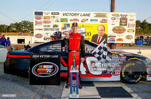 Kyle Benjamin driver of the Chevrolet poses with the trophy after winning the NASCAR KN Pro Series East Kevin Whitaker Chevrolet 140 at Greenville...