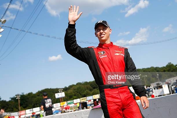Kyle Benjamin driver of the Chevrolet waves as he is introduced before the NASCAR KN Pro Series East Kevin Whitaker Chevrolet 140 at Greenville...