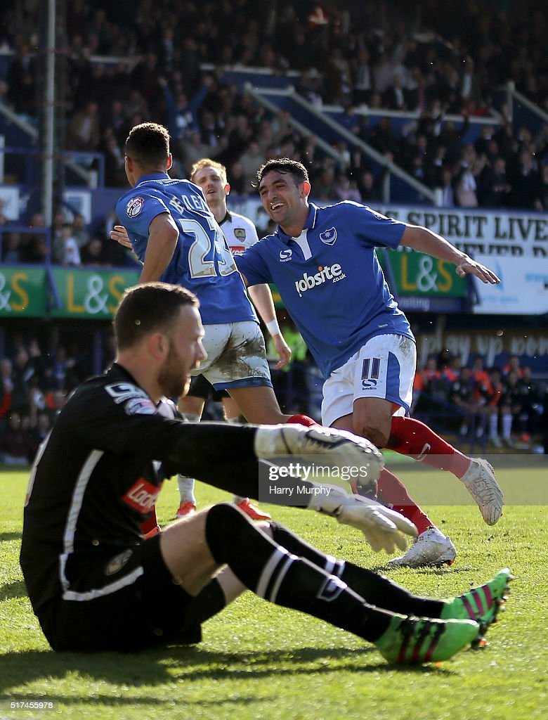 Kyle Bennett and Gary Roberts of Portsmouth celebrate during the Sky Bet League Two match between Portsmouth and Notts County at Fratton Park on March 25, 2016 in Portsmouth, England.