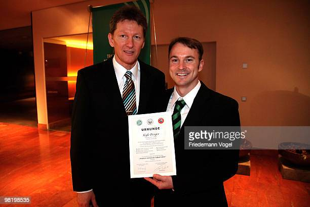 Kyle Berger receives his DFB Football Trainer Certificate from Frank Wormuth at the Inter Conti hotel on April 1 2010 in Cologne Germany