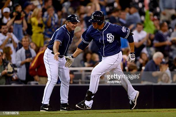 Kyle Blanks is congratulated by Glenn Hoffman of the San Diego Padres after hitting a home run against the Arizona Diamondbacks at Petco Park on June...