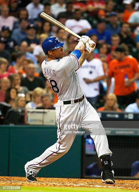 Kyle Blanks of the Texas Rangers swats a solo home run in the fifth inning during their game against the Houston Astros at Minute Maid Park on May 5...