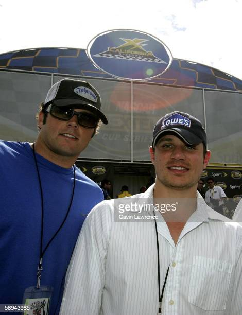 Kyle Boller Baltimore Raven's NFL Quarterback poses with Nick Lachey musician and actor during the NASCAR Nextel Cup Series Auto Club 500 on February...