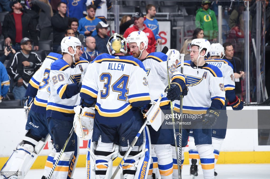 Kyle Brodziak #28, Alexander Steen #20, and Jake Allen #34 of the St. Louis Blues celebrate a victory over the Los Angeles Kings at STAPLES Center on March 10, 2018 in Los Angeles, California.
