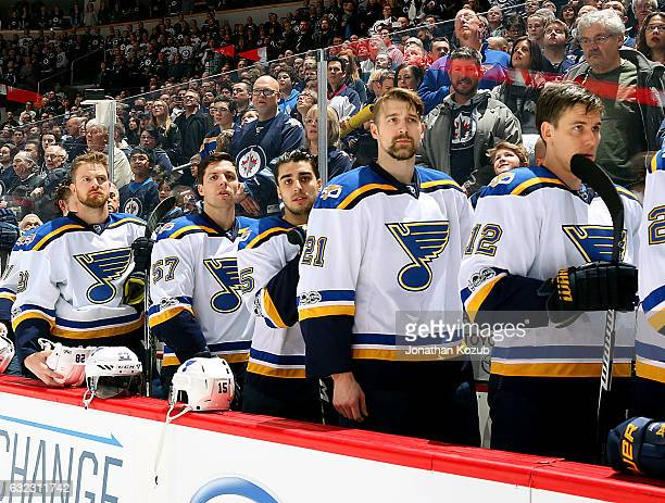 Kyle Brodziak David Perron Robby Fabbri Patrik Berglund and Jori Lehtera of the St Louis Blues stand on the bench for the National anthems prior to...