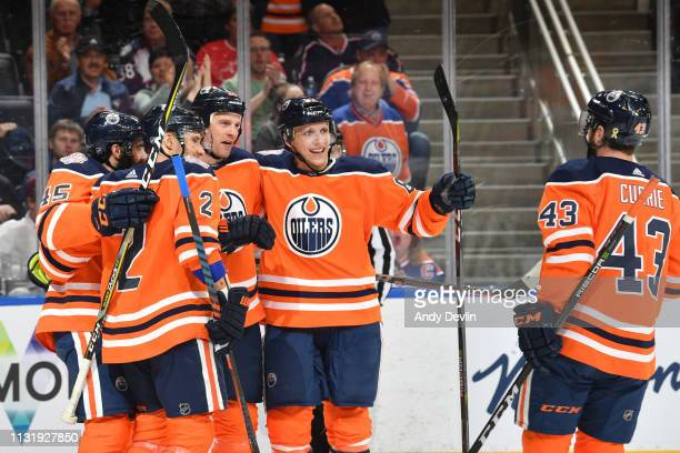 Kyle Brodziak Matthew Benning Josh Currie Andrej Sekera and Joseph Gambardella of the Edmonton Oilers celebrate after a goal during the game against...