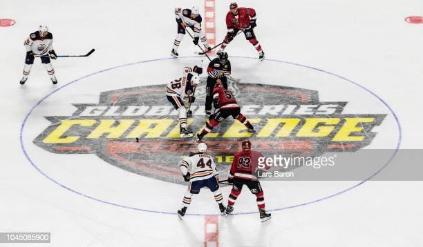 Kyle Brodziak of Edmonton challenges Colby Genoway of Haie during the NHL Global Series Challenge game between Edmonton Oilers and Kolner Haie at...