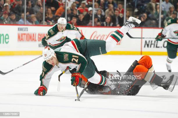 Kyle Brodziak of the Minnesota Wild and Ryan Getzlaf of the Anaheim Ducks collide during the game at the Xcel Energy Center on February 14, 2012 in...