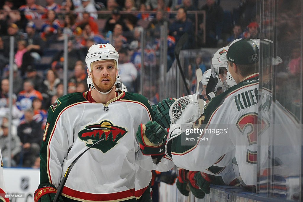 Kyle Brodziak #21 of the Minnesota Wild celebrates with teammates after a goal in a game against the Edmonton Oilers on April 16, 2013 at Rexall Place in Edmonton, Alberta, Canada.
