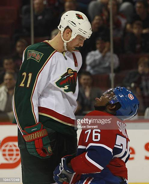 Kyle Brodziak of the Minnesota Wild confronts PK Subban of the Montreal Canadiens who sticks his tongue out at him at the Bell Centre on September 26...