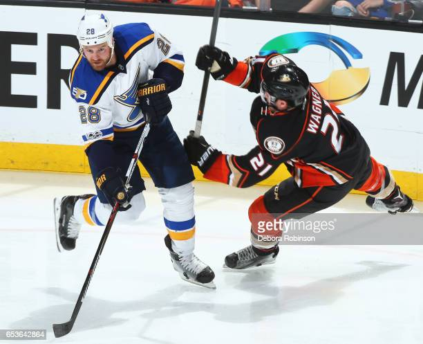 Kyle Brodziak of the St Louis Blues battles against Chris Wagner of the Anaheim Ducks during the game on March 15 2017 at Honda Center in Anaheim...
