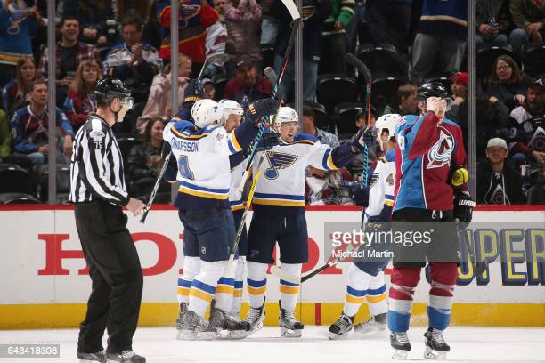 Kyle Brodziak of the St Louis Blues celebrates with teammates Scottie Upshall Jordan Schmaltz and Carl Gunnarsson after scoring a goal against the...