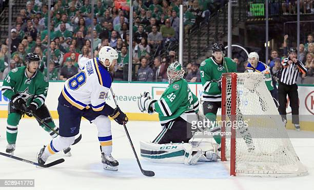 Kyle Brodziak of the St Louis Blues looks to rebound the puck as Kari Lehtonen of the Dallas Stars gives up a goal against the Blues in the second...