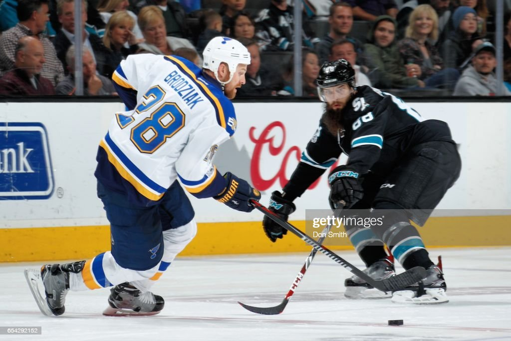 Kyle Brodziak #28 of the St. Louis Blues skates against Brent Burns #88 of the San Jose Sharks during a NHL game at SAP Center at San Jose on March 16, 2017 in San Jose, California.