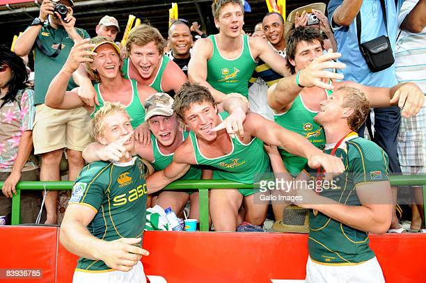 Kyle Brown and Phillip Snyman of South Africa celebrate with fans during the IRB Sevens Series final between South Africa and New Zealand December 6...
