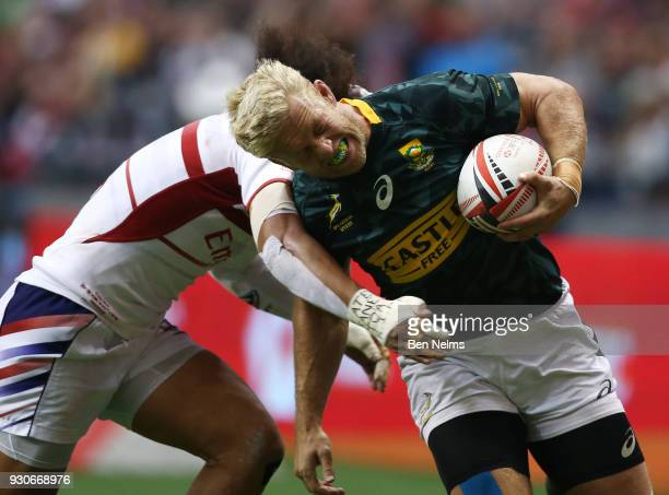 Kyle Brown of South Africa is tackled by Folau Niua of the United States during the bronze medal game at Canada Sevens the Sixth round of the HSBC...