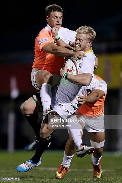 Kyle Brown of South Africa is tackled by Juan Cappiello of Argentina during the Tokyo Sevens, in the six round of the HSBC Sevens World Series at the...