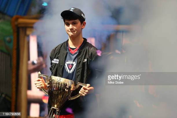 """Kyle """"Bugha"""" Giersdorf celebrates after winning the Fortnite World Cup solo final at Arthur Ashe Stadium on July 28 2019 in New York City"""