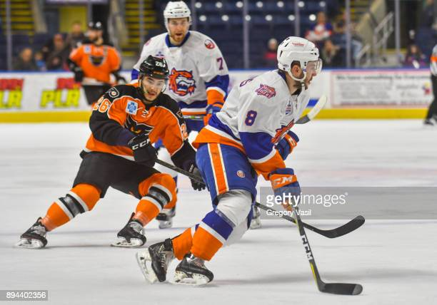 Kyle Burroughs of the Bridgeport Sound Tigers brings the puck up ice during a game against the Lehigh Valley Phantoms at the Webster Bank Arena on...