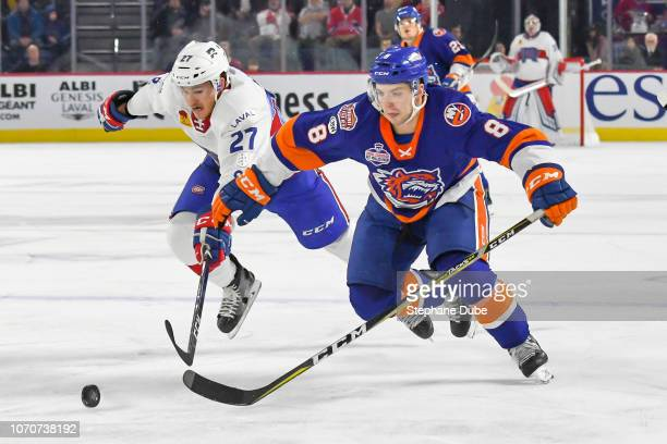 Kyle Burroughs of the Bridgeport Sound Tigers races for the puck against Alexandre Alain of the Laval Rocket at Place Bell on November 16 2018 in...