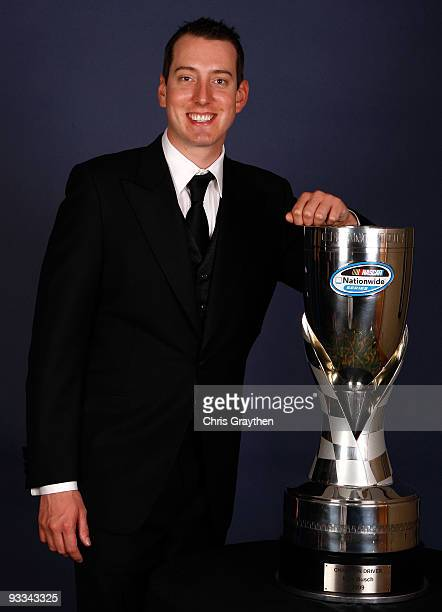 Kyle Busch 2009 NASCAR Nationwide Series Champion poses with his trophy during the NASCAR Nationwide/Truck Series Banquet at Loews Miami Beach Hotel...