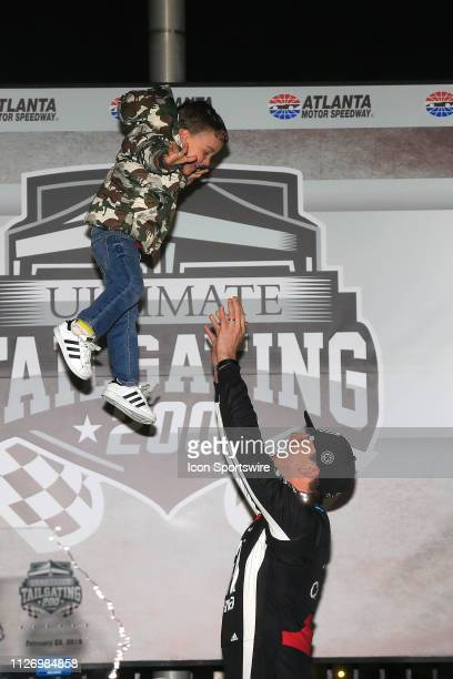 Kyle Busch and his son Brexton celebrate winning the 11th running of the Ultimate Tailgating 200 NASCAR Gander Outdoors Truck Series race on February...