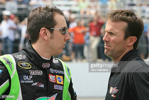 Kyle Busch dirver of the Interstate Batteries Toyota talks with JD Gibbs president of Joe Gibbs Racing prior to the NASCAR Sprint Cup Series LENOX...