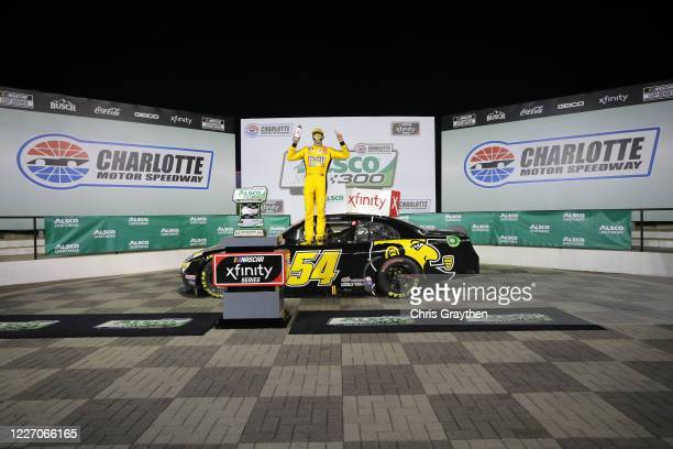 Kyle Busch driver of the App State Class of 2020 Toyota celebrates in Victory Lane after winning the NASCAR Xfinity Series Alsco 300 at Charlotte...