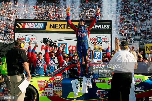 Kyle Busch driver of the Carquest/Kellogg's Chevrolet celebrates in victory lane after winning the NASCAR Nextel Cup Series Food City 500 at Bristol...