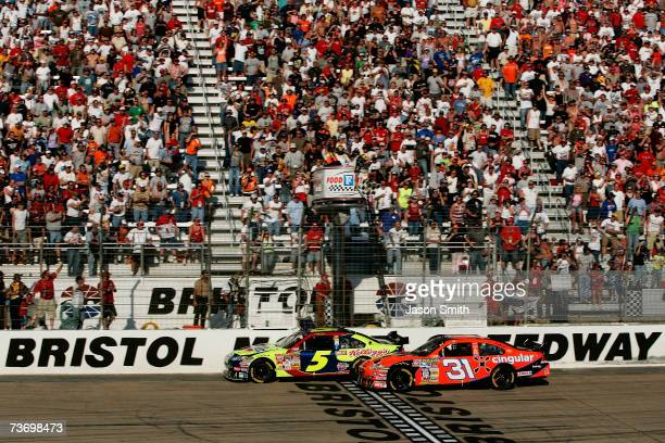 Kyle Busch driver of the Carquest/Kellogg's Chevrolet crosses the finish line ahead of Jeff Burton driver of the Cingular Chevrolet to win the NASCAR...