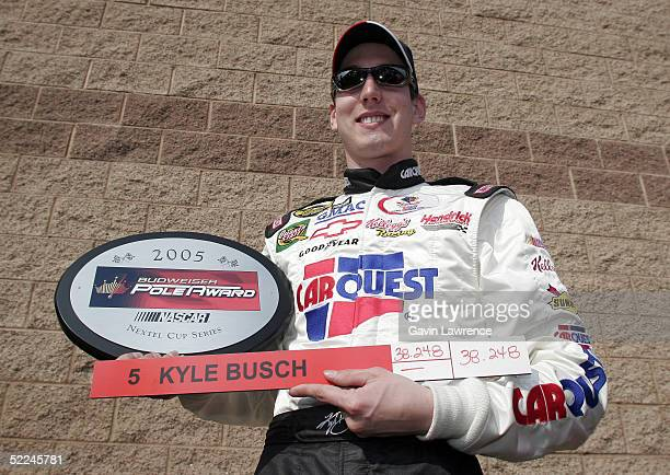 Kyle Busch driver of the Carquest/Kellogg's Chevrolet poses after qualifying in pole position for the NASCAR Nextel Cup Auto Club 500 on February 26...
