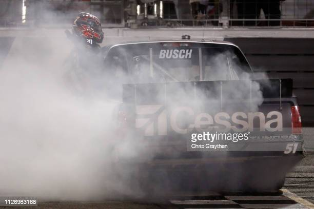 Kyle Busch driver of the Cessna Toyota celebrates after winning the NASCAR Gander Outdoors Truck Series Ultimate Tailgating 200 at Atlanta Motor...