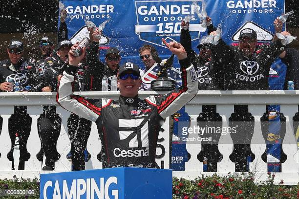 Kyle Busch driver of the Cessna Toyota celebrates in Victory Lane after winning the NASCAR Camping World Truck Series Gander Outdoors 150 at Pocono...