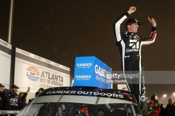 Kyle Busch driver of the Cessna Toyota celebrates in victory lane after winning the NASCAR Gander Outdoors Truck Series Ultimate Tailgating 200 at...