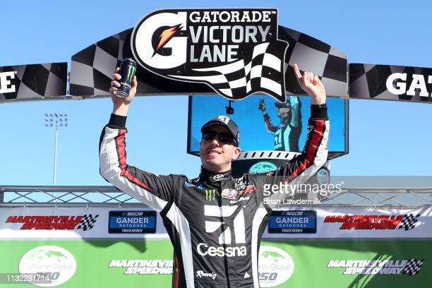 Kyle Busch, driver of the Cessna Toyota, celebrates in Victory Lane after winning the NASCAR Gander Outdoors Truck Series TruNorth Global 250 at...