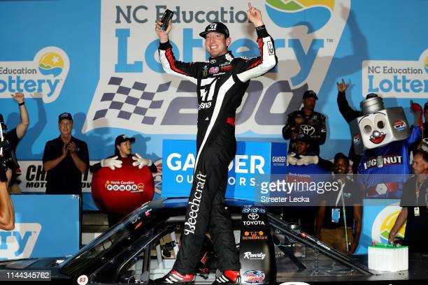 Kyle Busch driver of the Cessna Toyota celebrates in victory lane after winning the NASCAR Gander Outdoors Truck Series North Carolina Education...