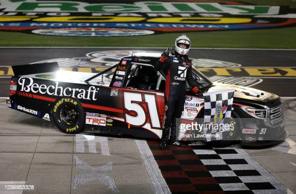 Kyle Busch, driver of the Cessna Toyota, celebrates winning the NASCAR Gander RV & Outdoors Truck Series Vankor 350 at Texas Motor Speedway on July...