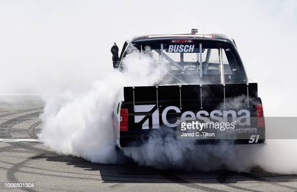 Kyle Busch, driver of the Cessna Toyota, celebrates with a burnout after winning the NASCAR Camping World Truck Series Gander Outdoors 150 at Pocono...