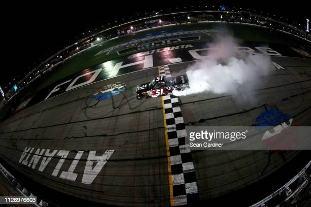 Kyle Busch driver of the Cessna Toyota celebrates with a burnout after winning the NASCAR Gander Outdoors Truck Series Ultimate Tailgating 200 at...